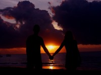 Romantic vacation, couple watching sunset