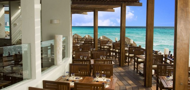 Beachfront restaurant at ME Cancun Complete