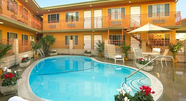 Pool and backyard at Studio Inn and Suites